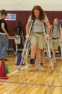Cameron George takes a walk in another persons shoes as she learns what it would be like to have a disability at the SAGE CARE workshop held at Davis Intermediate Sept. 8. The purpose of the workshop was to give students the opportunity to see the world the way others around it.