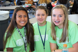 """Wylie East students Maddie Almario, Lauren Bickers and Destini Cole wear green in honor of the Wylie ISDs five day 'Power Challenge"""". The event was sparked in an effort to call attention to electricity usage and options on reducing usage."""