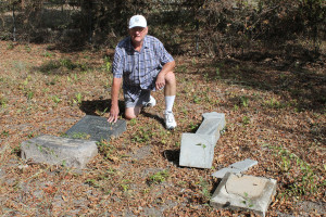 Wylie resident Percy Simmons checks a pair of markers for his ancestors graves that have toppled at Clear Lake Cemetery. Simmons complained last week about access to the cemetery which is somewhat limited during winter months.