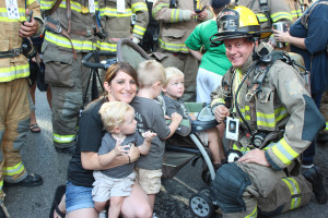 Wylie Firefighter Brandon Storm participated in the Dallas 9/11 Memorial Stair Climb Sept. 5, and his family was there to support him. From left, Liam, 4; wife Stephanie; Asher, 2; and Cooper, 1.