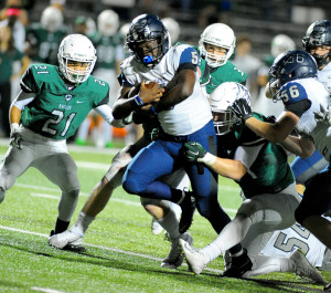 Evan Ghormley/The Wylie News Eno Benjamin bursts through the Prosper defense during last Friday's one-point victory.