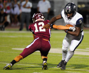 Oladipo Awowale/The Wylie News Wylie East's Eno Benjamin (5), here attempting to get by Parker Hawkins (12), had a huge night Friday, rushing for more than 200 yards and three touchdowns to lead the Raiders past their cross-town foes.