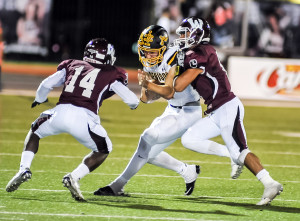 Oladipo Awowale/The Wylie News Gasevan McGrue (14) and Max Lopez converage on a Denison ball carrier during last Friday's 31-21 win.