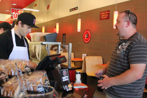 Owner of the Jimmy John's located off of FM 544, Matt Morton, helps with daily operations by taking a customers order behind the cash register. Morton enjoys working with his employees to better understand what they deal with and how to make his business more efficient.