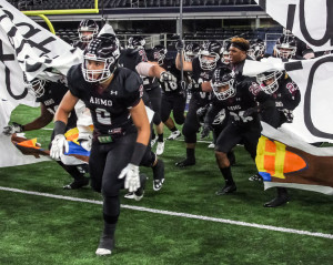 Oladipo Awowale/The Wylie News The Pirates charge on to the field at AT&T Stadium for last Saturday's area-round clash with Rockwall Heath, which Wylie won 24-17.
