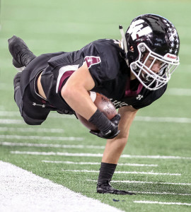 Oladipo Awowale/The Wylie News Wide receiver Kollier Knight does what he can to stay inbounds after a catch and run during last Saturday's Region II semifinal loss to Longview at AT&T Stadium.