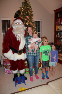 Santa Claus visited the Durrett family of Wylie last week, courtesy of Texas Motor Speedway. Pictured with Santa are, l-r, Kelly, Margot, Owen and Alice Durrett.