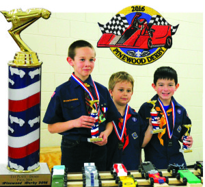 Winners of the 2016 Pinewood Derby from Cub Scout Pack 304 proudly display their trophies. From left, first place winner A.J. Flory, second place winner Neil Wise and third place winner Dane Ross. The derby was held on Saturday, Jan. 30 at the Bart Peddicord Community Center in Wylie.