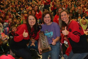 Smith Elementary School students and administration were the proud winners of the Wylie ISD Power Challenge held last fall. The award was presented to the school that saved the most energy. Principal Kellye Morton, left, School Board Member Stacie Gooch, middle, and Assistant Principal Jamie Fletcher, right, accepted their trophy during their weekly Bulldog Boogie event. The district will hold a second challenge April 25-29, with a formal kick off day scheduled for Earth Day, April 22.