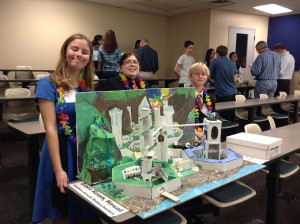Participants in the 'Future City' science fair competition share their idea of the ideal future city. Pictured, from left, are Paige Smith, Sammy Flanagan and Evan Smith.
