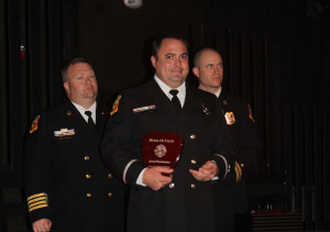 For a swift water rescue last year, Travis Araugo, pictured, and Jared Buchmeier were awarded the Medal of Valor by Wylie Fire Rescue. Pictured behinc Araujo are Asst. Chief Brandon Blyth and Capt. Casey Nash.