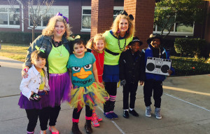 These Hartman Elementary students just want to have fun. Rocking their 80s gear are, pictured from left, Juliet Salazar, Assistant Principal Krista Wilson, Lilia Bagdasarian, Taela Richards, Principal Shawna Ballast, Julian Walker and Patrick Walker.
