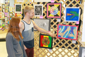 Art projects of all types were on display at the Celebrate the Arts event at WHS March 19. Matt Wilcox and Julia Farthing admire the works of art.