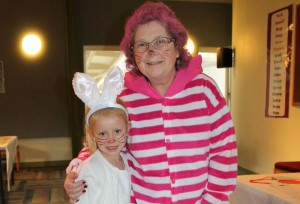 The White Rabbit, Addison Bennett, 6 year-old daughter of Megan Bennett, hopped around Smith Public Library during the Mad Hatter Tea Party.