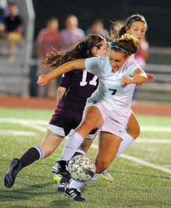 Evan Ghormley/The Wylie News The Lady Raiders' Lauren Wentz gets her foot on the ball against Sherman.