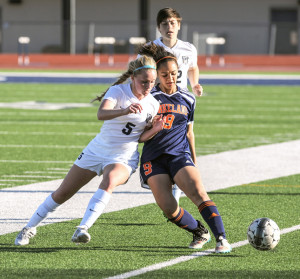 Evan Ghormley/TheWylieNews Reilly Clark (5) goes shoulder to shoulder with a Wakeland player while in pursuit of the ball.
