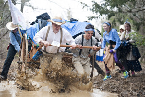 Pioneer trek participants pushed through rain and muddy waters as they reenacted a 10 mile trek from many years ago. The youth pioneers pushed approximately 500 pounds on a hand cart as they traveled the trails at Lake Ray Roberts State Park. Pictured, from left, are Carlos Garza, Joe Muir, Ryan Rigby, Breanna Taylor and Sarah Porter.