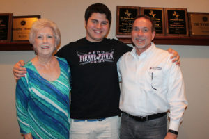 Wylie High School senior student Barrett Phillips wraps up his association with the Children's Chorus of Collin County, of which he is a charter member, this spring. Pictured with Phillips are chorus founders Janie Oliver and Russ Porter.