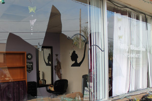 Joe Reavis/The Wylie News Plate glass windows at A New You were smashed by hailstones as big as softballs that stuck Wylie early Monday evening.