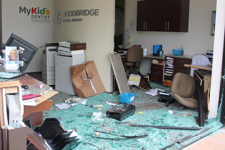 Woodbridge suffers damage as car goes through building