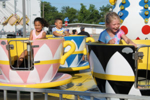 First Baptist Wylie welcomed the carnival to town June 15 - 19 with multiple kiddie rides, arcade games and fair food for all to enjoy. Above, spinning teacups never run out of style as they guarantee some dizzying delights for all. Proceeds from the carnival offset the Vacation Bible School costs to allow for free admission to VBS for approximately 1,000 children.