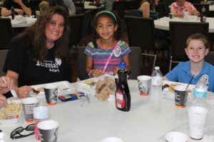 The Hart family, Bridgett, Rebecca and Jeremiah, enjoy their breakfasts at Pancakes with Fire and Police, a fundraiser for Jeremiah held Saturday in Wylie. Jeremiah lost a leg as the result of a car/pedestrian accident in November 2016.