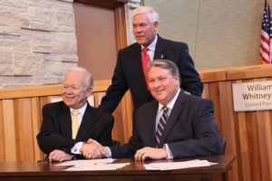 EPA Regional Manager Ron Curry and Mayor Eric Hogue sign documents formalizing completion with U.S. Rep Pete Sessions overseeing the action.