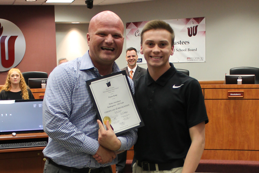 Graduate carries on legacy of perfect attendance