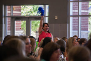 New teacher Jennilea Carroll gets spirited about winning a prize at the luncheon held Thursday, Aug. 4 at Wylie East.