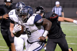 Wylie East senior Eno Benjamin motors through the Rockwall Heath defense during last Friday's 24-21 last-second win. The senior, one of the state's top running backs, is not the Raiders' starting quarterback. East will go for its second win of 2016 this Friday in Hallsville.