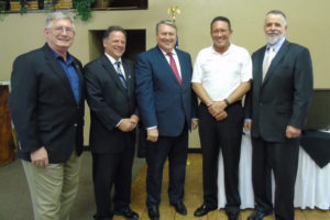 Garland Mayor Doug Athas, Sachse Mayor Mike Felix, Wylie Mayor Eric Hogue, Rowlett Mayor Todd Gottel and Murphy Mayor Eric Barna gather together after the mayoral luncheon held August 9 in the Woodbridge Golf Club Pavilion.