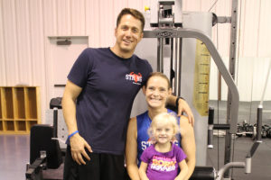 Strong Fitness Ministry opened this month in Wylie as a nonprofit gym combining physical and spiritual fitness. Pictured are owners Jacob and Lauren and Lauren Davis, with daugher Aleece.
