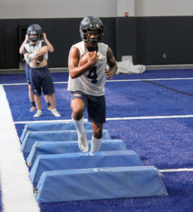Greg Ford/The Wylie News Corbin Johnson undergoes a running back agility drill at Wylie East's new indoor practice building.