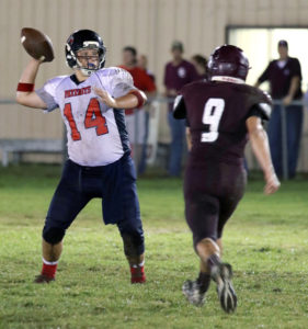 Courtesy Julie Lipp Gavin Jarrett attempts a pass during the Patriots 34-7 season opening victory last Friday at Savoy. Wylie Prep will play 7:30 p.m. this Friday at Tioga.