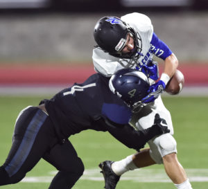Shane Roper/The Wylie News Raider defensive back Corey Gentle is anything but that as hs dislodges the pigskin from a North Forney ball carrier.