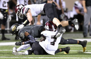 Roosevelt Joubert/The Wylie News The Pirates' Gasevan McGrue (7) combines with Kevin Watts to bring down Plano East wide receiver Mikail Simmons