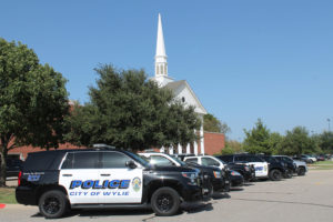 Wylie Police Department patrol cars line up for the funeral of 8-year-old Xander Wade who died Monday after battling lifelong medical conditions. Xander was made an honorary Wylie Police officer this summer.