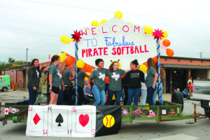 Members of the Wylie High softball team ride on a Las Vegas theme float in the homecoming parade and pep rally in downtown Wylie Sept. 26.