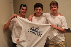 Three classmates from Wylie East High School, from left, Myrick Navejar, Parker Marshall and Everett Janway, show off their original design in the Prep Tide line of clothing they created.