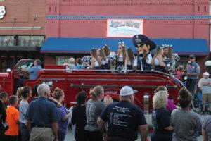 Wylie East High School cheerleaders and Rowdy the Raider cruise down Ballard Avenue Oct. 17 for their annual Homecoming parade.