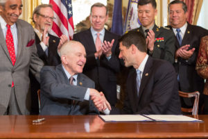 U.S. Rep. Sam Johnson, left, receives congratulations from Speaker of the House Paul Ryan for his work on a bill to add a Wall of Remembrance to the Korean War Memorial.