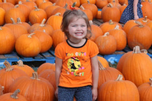 She may be too cute to care but 2-year-old Elizabeth Wagner, daughter of Greg and Kristin Wagner of Wylie, tried on her best smile at the pumpkin patch at First United Methodist Church of Wylie.