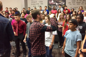 Chris Wardle (in plaid) of Voces8 leads the alto section during an improvisation exercise at Wylie High School last week.