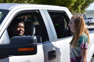 Student A.J. Bankhead is stopped in her vehicle by WEHS Criminal Justice student Sara Johnson. The student initiated stops simulated violator contact as part of a class exercise led by David Lanman.