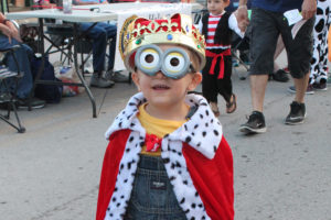 King Bob the Minion (Oakley Odell, 2, of Wylie) makes the rounds for candy during Boo on Ballard.