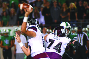 Parker Cusey (74) provides pass protection for Wylie quarterback Emilio Ames during Friday's 28-3 bi-district loss at Southlake Carroll. Cusey is currently hospitalized and being treated for stroke-like symptoms following the contest.