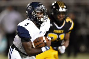 Wylie East's Eno Benjamin motors for extra yardage in last Friday's 49-28 win at Forney, which clinched a postseason berth for the Raiders. Wylie also clinched a spot with a 28-21 win over McKinney.