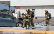 Emergency services extinguish car fire