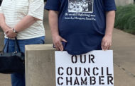 Protestors show displeasure with mayor's prayer comments