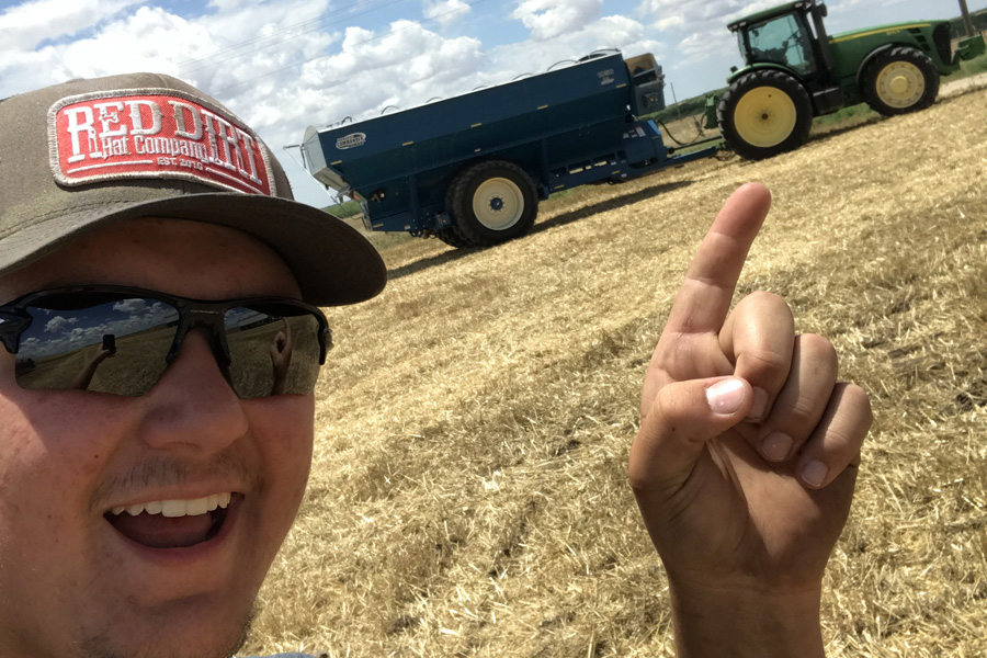 Student travels, works long hours harvesting wheat